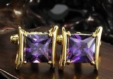Spinki do mankietów złoty kolor z fioletowego kryształu